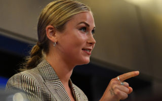 Grace Tame speaks at the National Press Club on March 03, 2021 in Canberra, Australia. Tame, named Australian of the Year for her advocacy work for sexual assault survivors, has called for a definition of consent to be established federally and taught in schools as early as possible