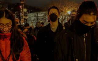Protesters gather for a silent vigil in the Chinatown neighborhood of Washington on Wednesday, March 17, 2021, after eight people were shot to death at three spas in the Atlanta area on Tuesday evening. On platforms such as Telegram and 4chan, racist memes and posts about Asian-Americans have created fear and dehumanization.