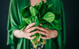 Young woman holding spinach