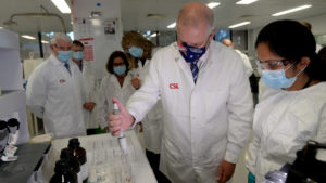 Prime Minister Scott Morrison meets CSL staff working on the COVID vaccine while he tours the company's facility in Melbourne, Friday, March 26, 2021. (AAP Image/Andrew Henshaw)