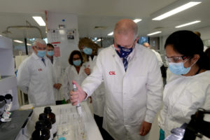 Prime Minister Scott Morrison meets CSL staff working on the COVID vaccine while he tours the company's facility in Melbourne, Friday, March 26, 2021