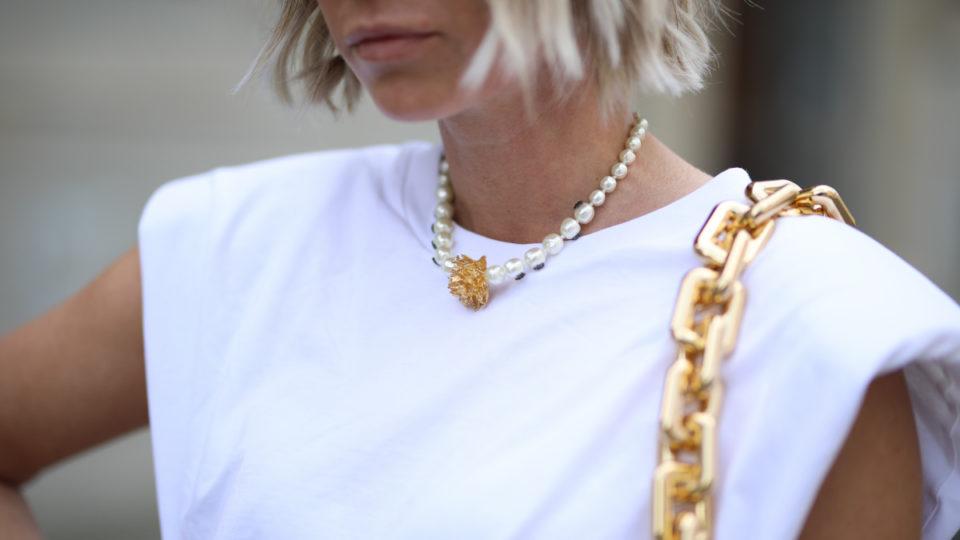 Karin Teigl wearing Bottega Veneta bag, Dior chain and Monki shirt on May 31, 2020 in Augsburg, Germany