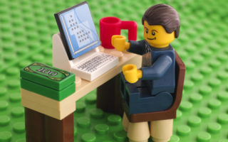 Lego businessman at his working place