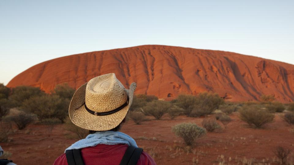 Tourist watching sunrise at Uluru