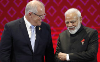Australia's Prime Minister Scott Morrison (L) chats with India's Prime Minister Narendra Modi (R) during the 14th East Asia Summit on the sidelines of the 35th Association of Southeast Asian Nations (ASEAN) Summit and Related Summits at Impact Muang Thong Thani in Nonthaburi province, Thailand, 04 November 2019.