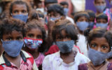 Pictures of children from Chennai, India wearing mask against covid-19 second wave in India. World vision India is helping communities to fight against Covid by providing Masks and sanitizers