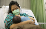 Mother with her newborn baby in the hospital