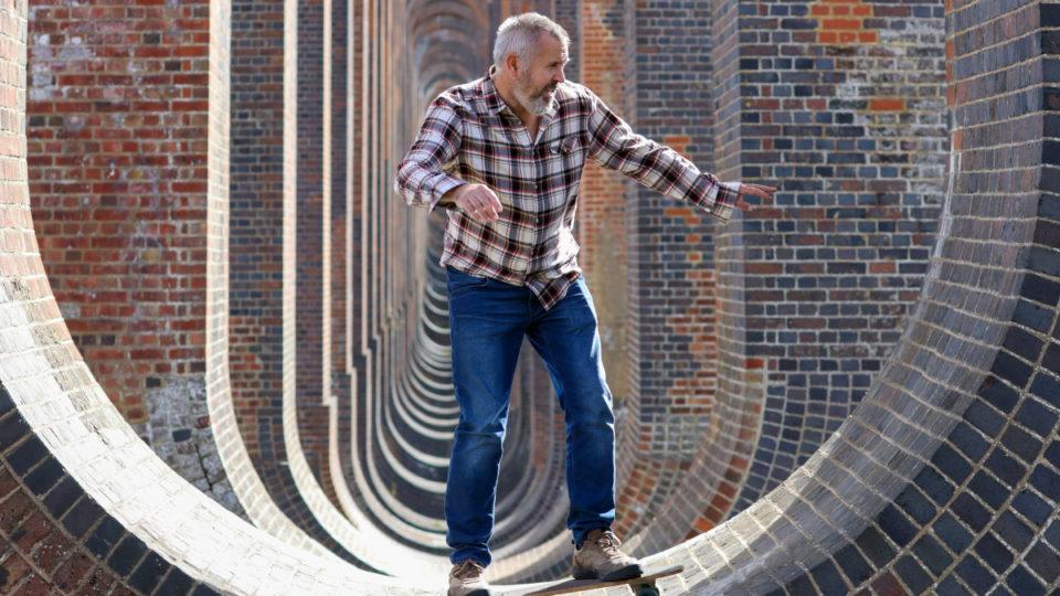 An older man on a skateboard