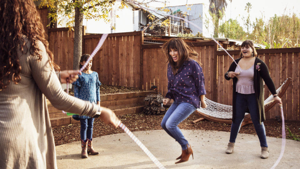 Young people playing with skipping rope