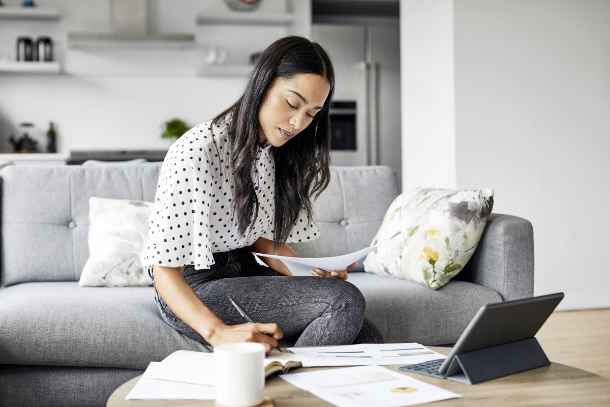 Woman budgets home finance document