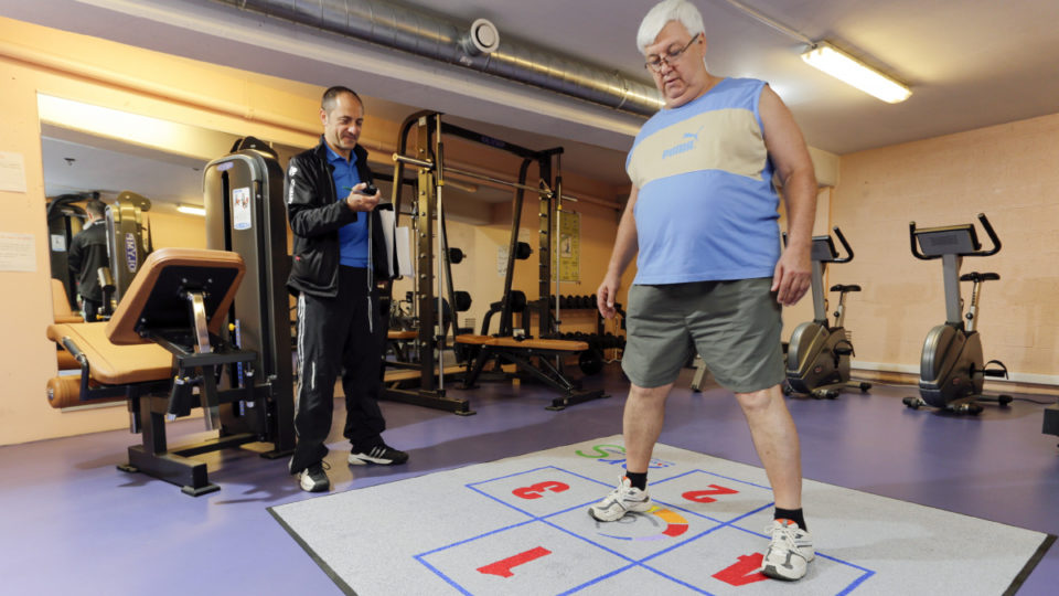 Overweight man exercising