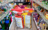 Snack packs in shopping cart at supermarket