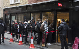 Every Thursday the fashion label Supreme, which is a skateboarding shop / clothing brand releases new lines and so fans of the brand queue outside this shop in Soho to be first in line for some original fashions in London, England, United Kingdom. (