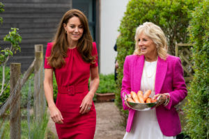 Kate, Duchess of Cambridge, left, and United States first lady Jill Biden, carrying carrots for the school rabbit, visit Connor Downs Academy in Hayle, England, Friday, June 11, 2021. (Aaron Chown)