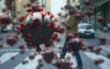 Digital illustration of macro Covid-19 cells floating over a woman wearing a face mask, using a smartphone, crossing the street