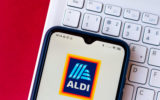 n this photo illustration, an ALDI logo seen displayed on a smartphone.