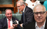 Treasurer Scott Morrison hands Deputy Prime Minister Barnaby Joyce a lump of coal during Question Time in the House of Representatives at Parliament House in Canberra, Thursday, Feb. 9, 2017