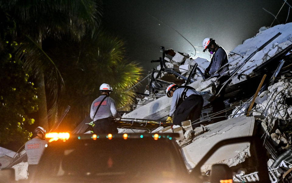 Banging, noises from beneath rubble of fallen Miami tower