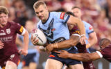 Tom Trbojevic of the Blues is tackled during game one of the 2021 State of Origin series between the New South Wales Blues and the Queensland Maroons at Queensland Country Bank Stadium on June 09, 2021 in Townsville, Australia