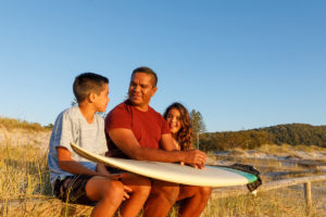 Australian Aboriginal Father and children at the beach in the early morning