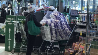 A shopper is panic buying ahead of lockdown