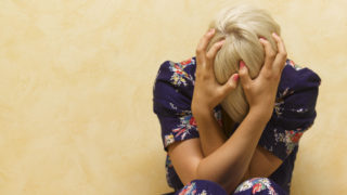 A woman in pain due to a migraine