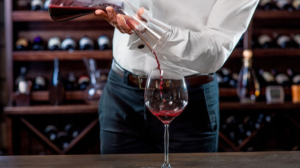 Pouring wine from a decanter into a glass