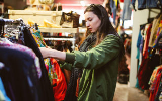 Woman shopping in London second hand marketplace
