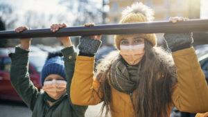 Kids wearing anti virus masks playing outside