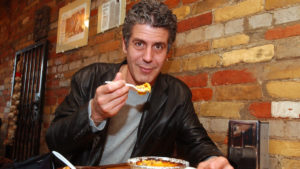 Chef Anthony Bourdain samples Chilean corn pie in Jumbo Emapandas restaurant in Kensington Market in Toronto Tuesday April 2, 2002