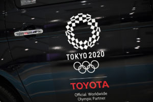 An Olympics games logo is seen on a displayed car at Toyota showroom in Tokyo on November 6, 2020