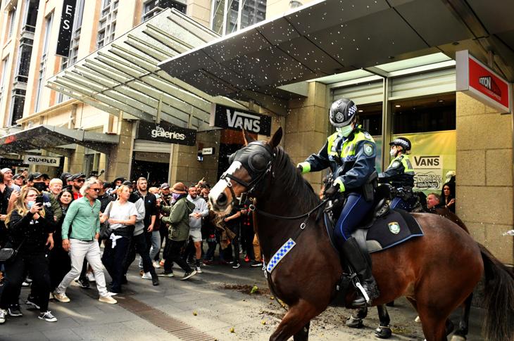 Police keep protestors at bay