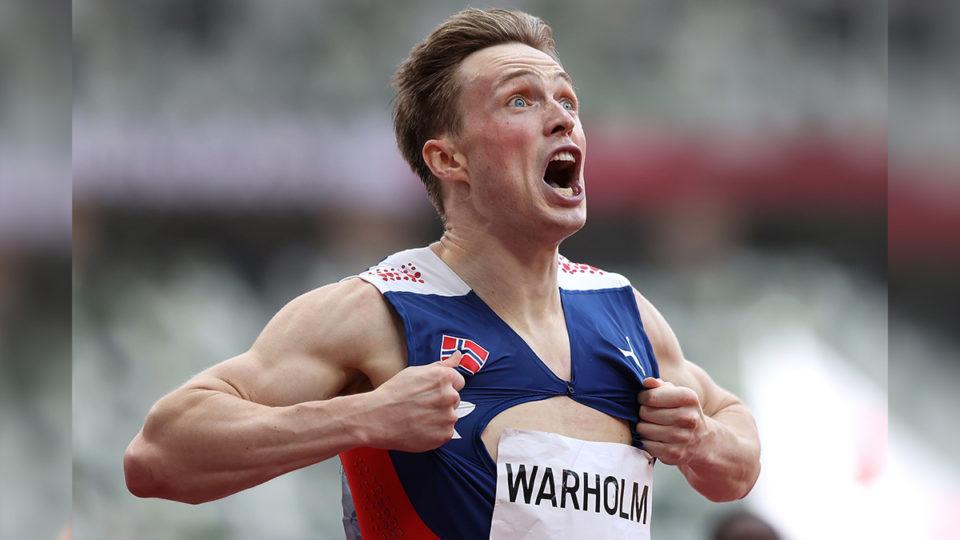 Karsten Warholm celebrates gold.