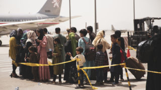 handout photo made available by US Central Command Public Affairs shows civilians preparing to board a plane during an evacuation at Hamid Karzai International Airport, Kabul, Afghanistan, 18 August 2021