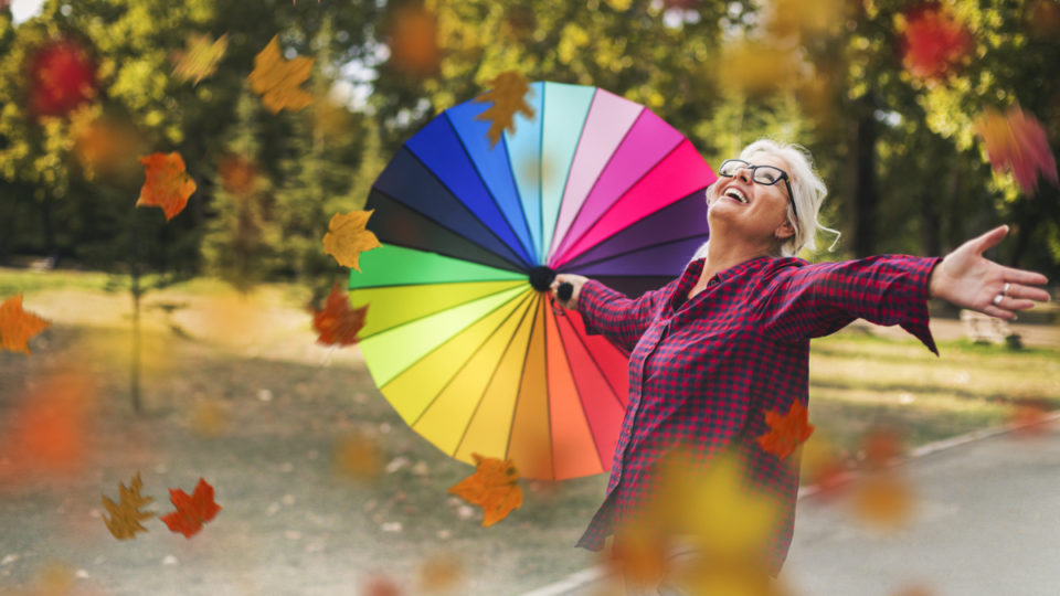 Happy mature woman outdoors in autumn