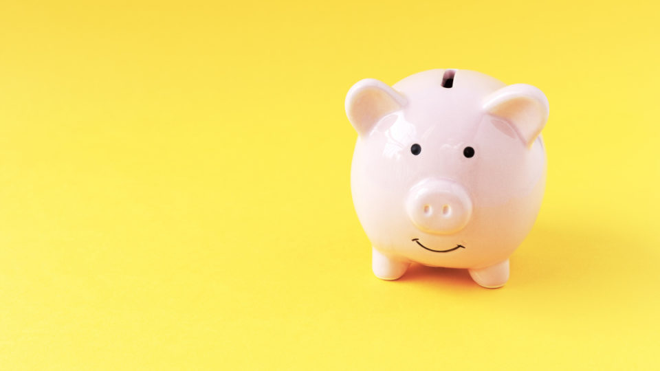 organised yellow piggy bank personal finance getty