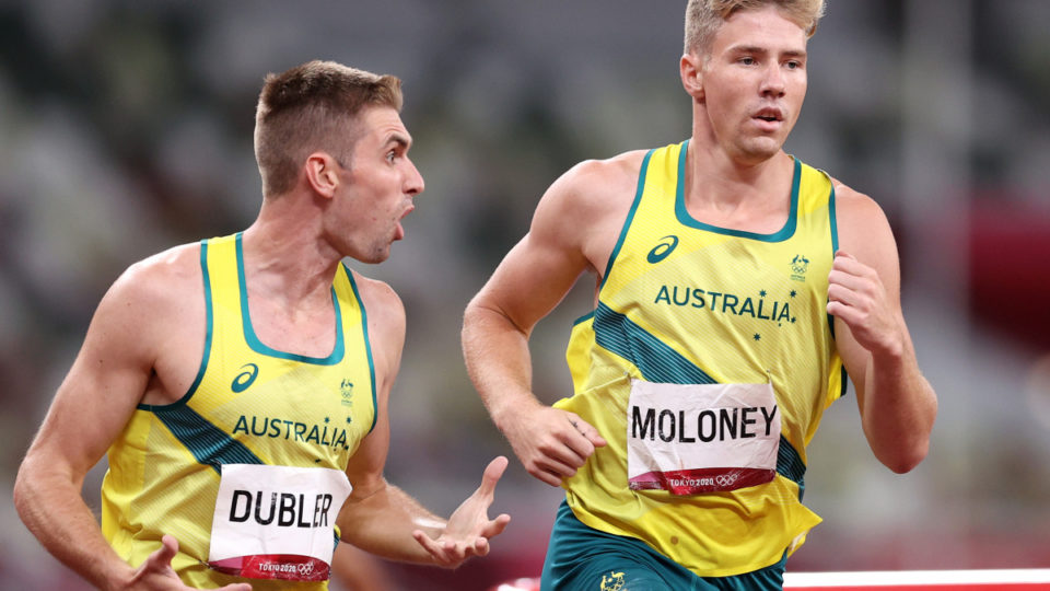 Cedric Dubler urges on Ashley Moloney in the 1500m to a decathlon bronze medal. Photo: Getty