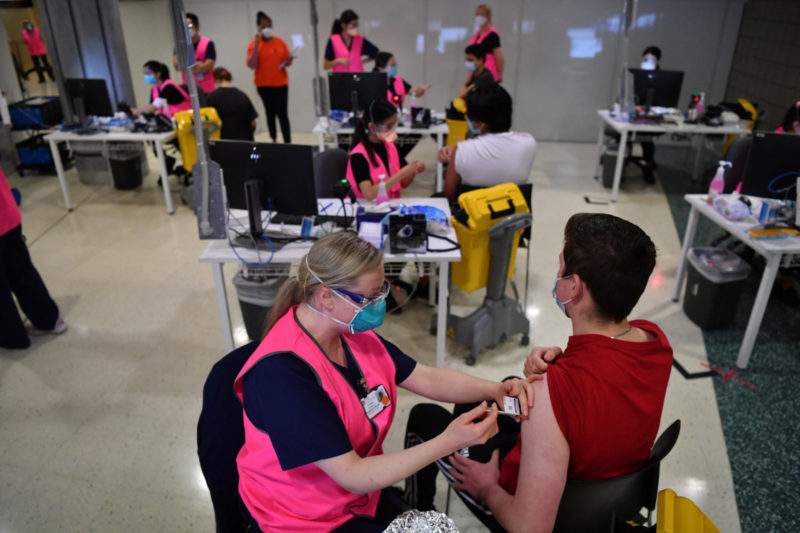 Students receive their first dose of the Pfizer Covid-19 vaccine in Sydney on August 9, 2021,