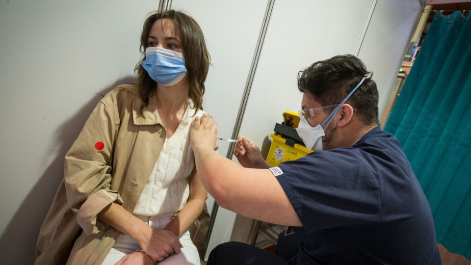 young woman receives the pfizer vaccine at the Royal Exhibition Building Vaccination Centre in Carlton on August 25, 2021 in Melbourne