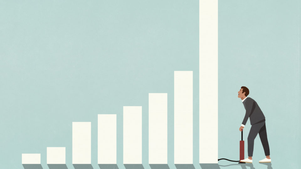 investing businessman inflating bar graph